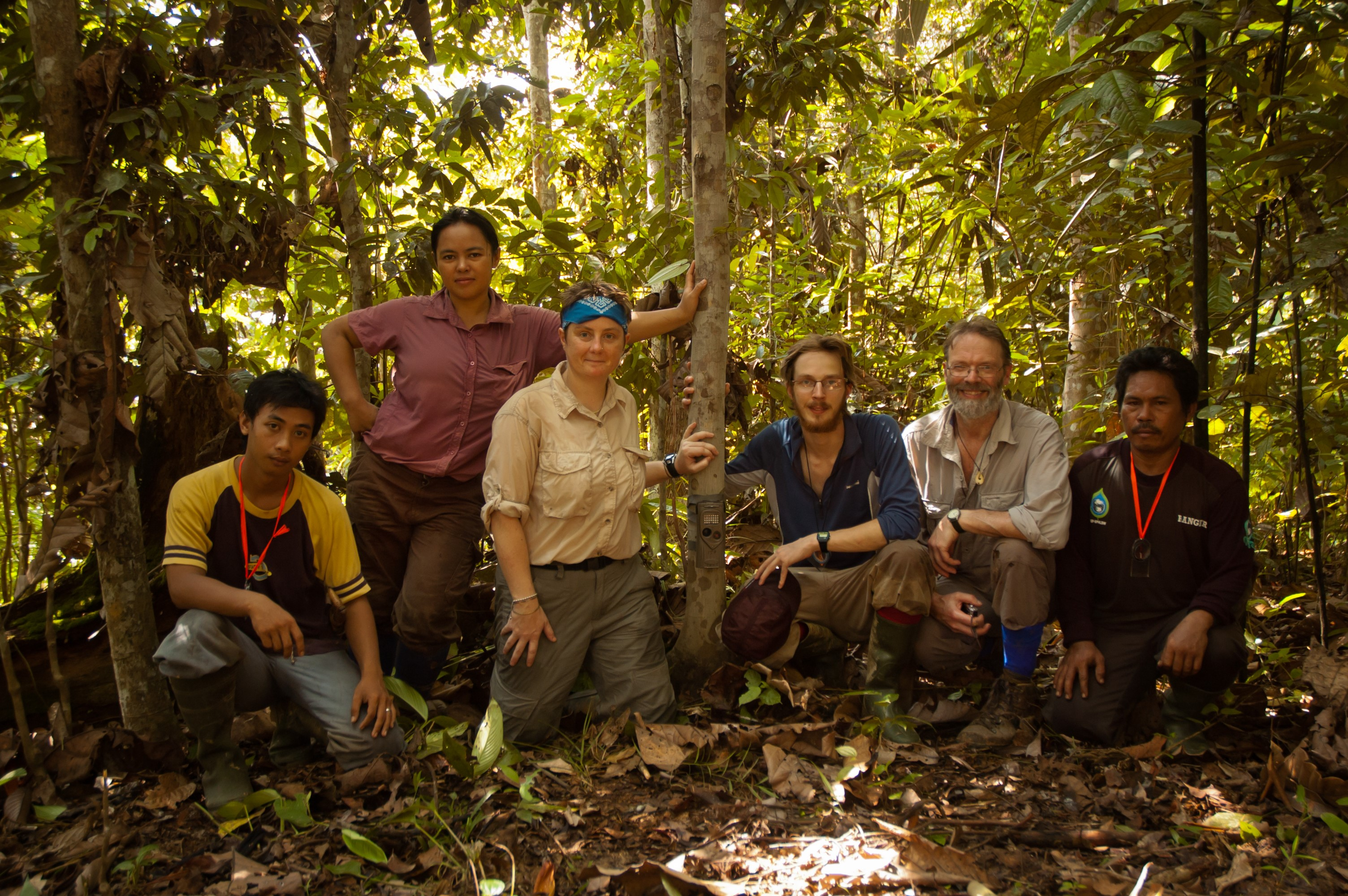 Ewan Macdonald (3rd from right) and David Macdonald (2nd from right) setting camera traps for clouded leopards with their team in Borneo.